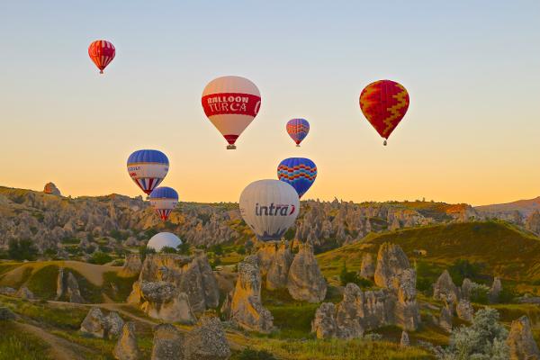 Balloons in Rocky Landscape